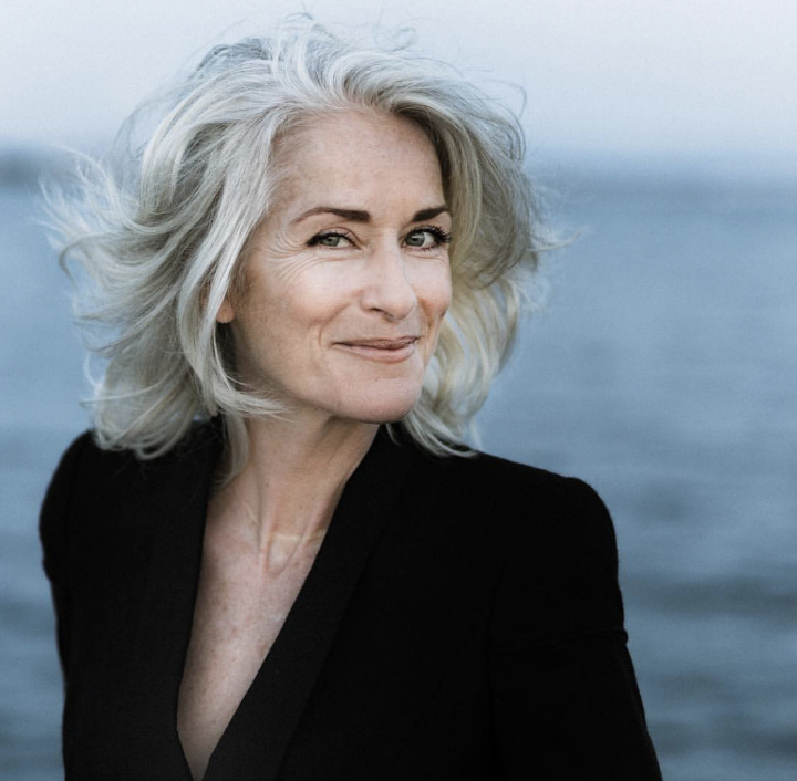 How to grow gray gracefully - smiling woman with wavy gray hair