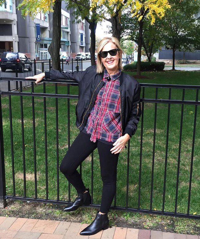 Bold plaid shirt with Chelsea boots, leggings and a black bomber jacket