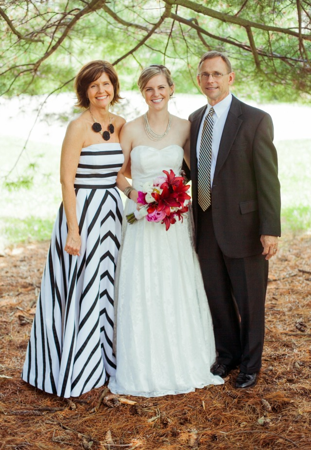 Mother Of The Bride In Black And White Striped Strapless Gown With Husband Daughter