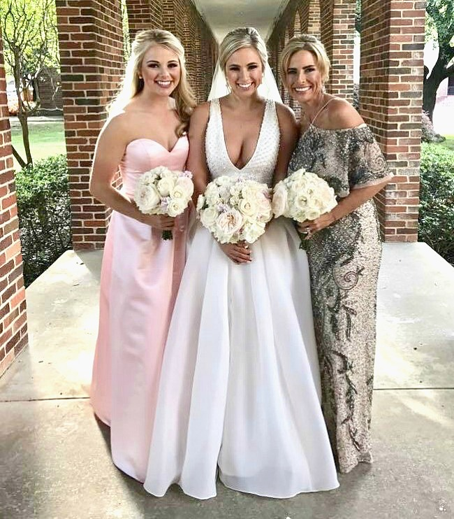 mother of bride-laurie in gold sparkly gown with bride and bridesmaid