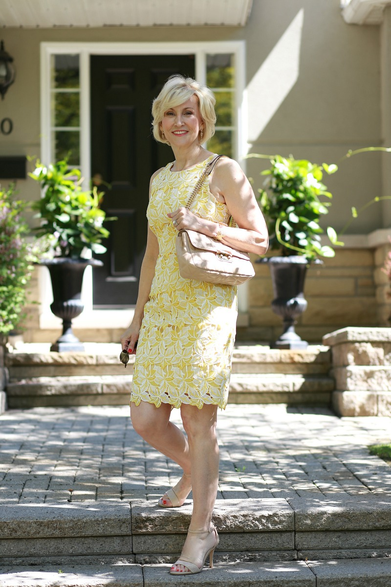 White and yellow lace summer dress worn by Deborah Boland | Fabulous After 40