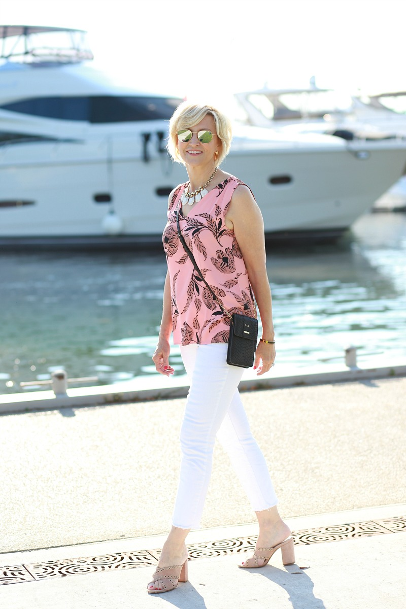coral and black sleeveless top with white jeans | Deborah Boland | Fabulous after 40