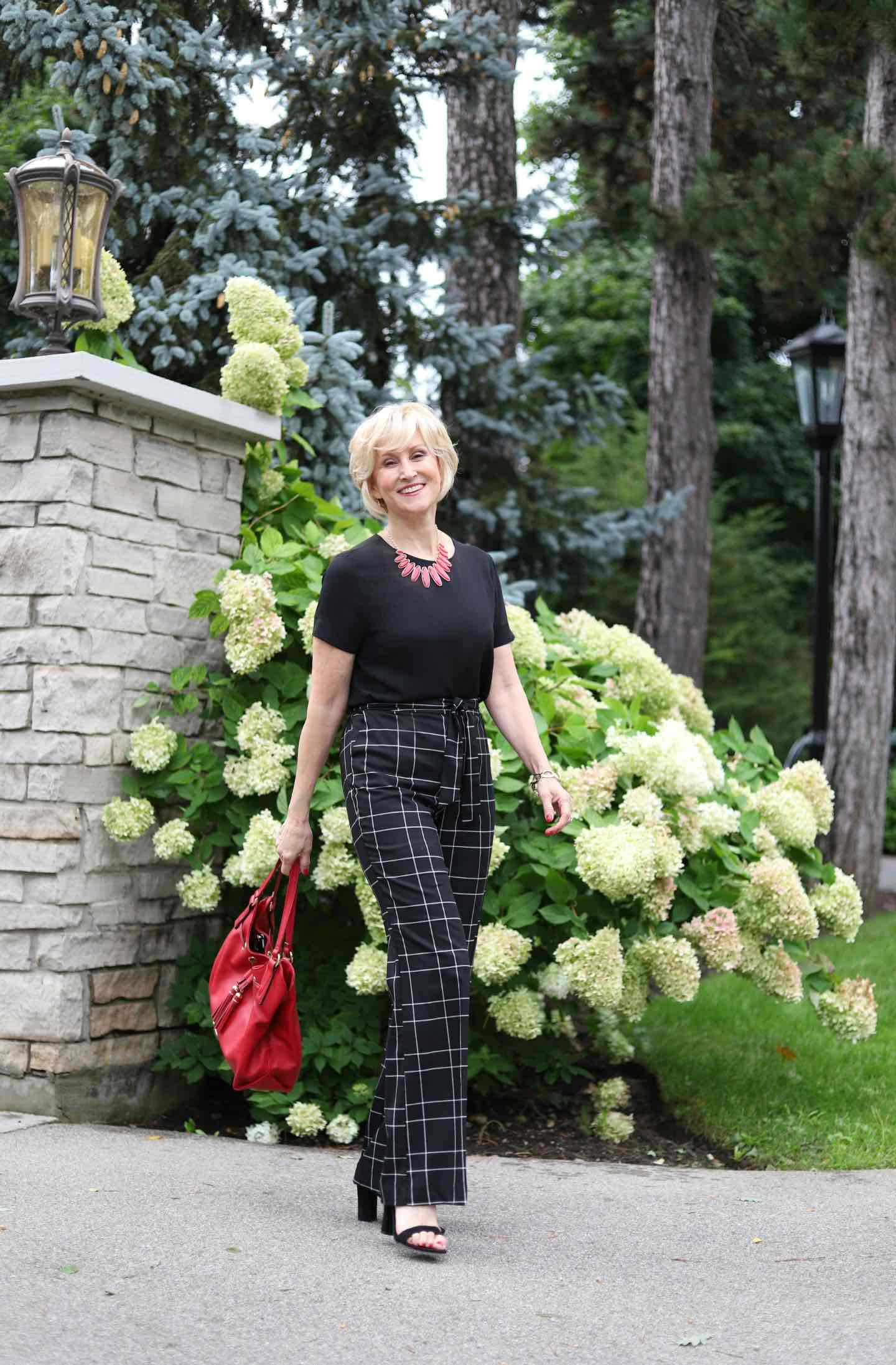 Styling Tips for Check and Plaid Pants| Black Windowpane check pants and black top worn by Deborah Boland | Fabulous After 40