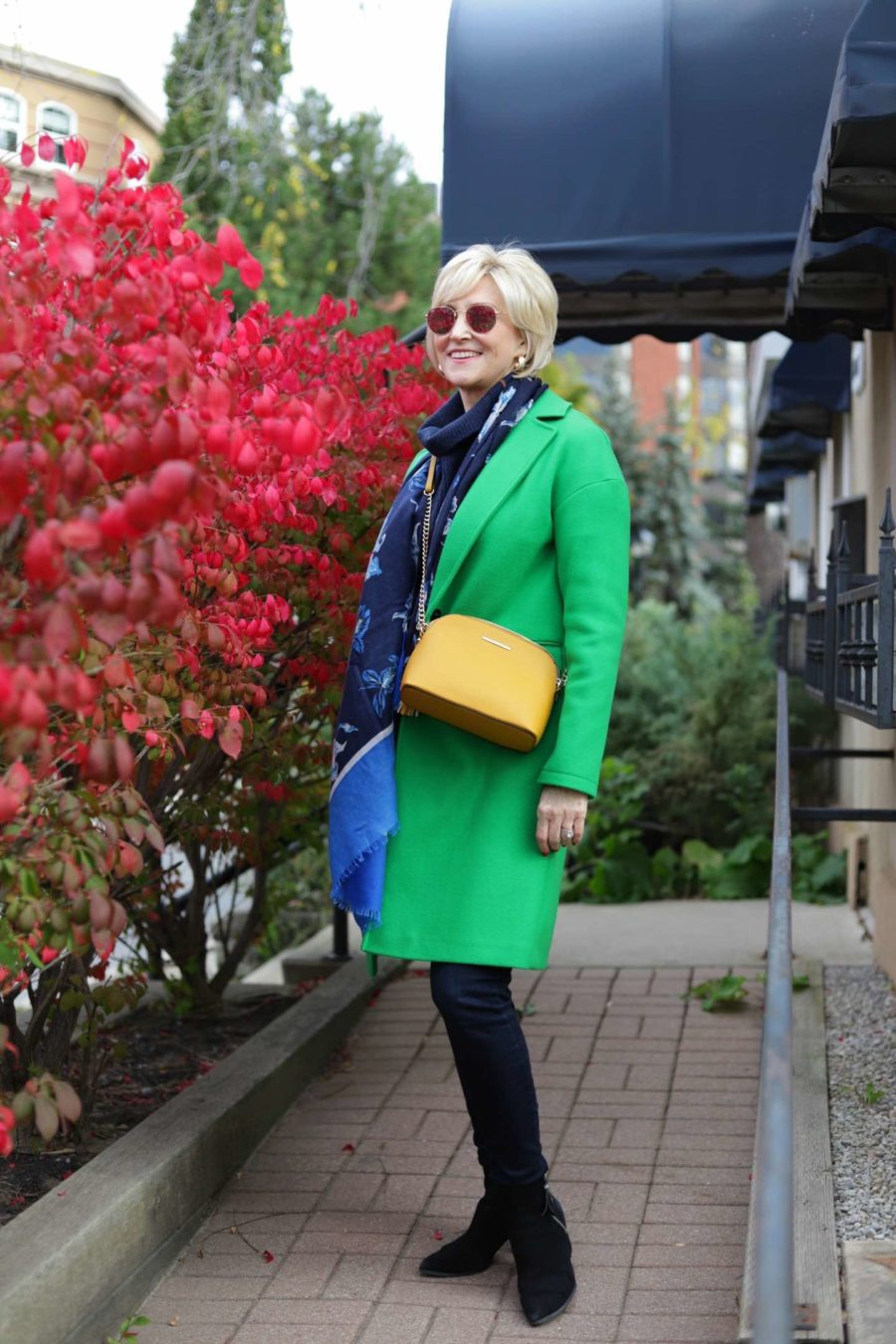 Topshop apple green midi coat worn by Deborah Boland | Fabulous After 40