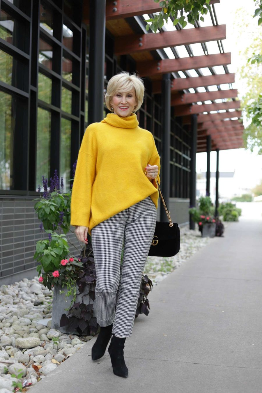 Women's oversized turtleneck sweater with check cropped pants worn by Deborah Boland |Fabulous After 40
