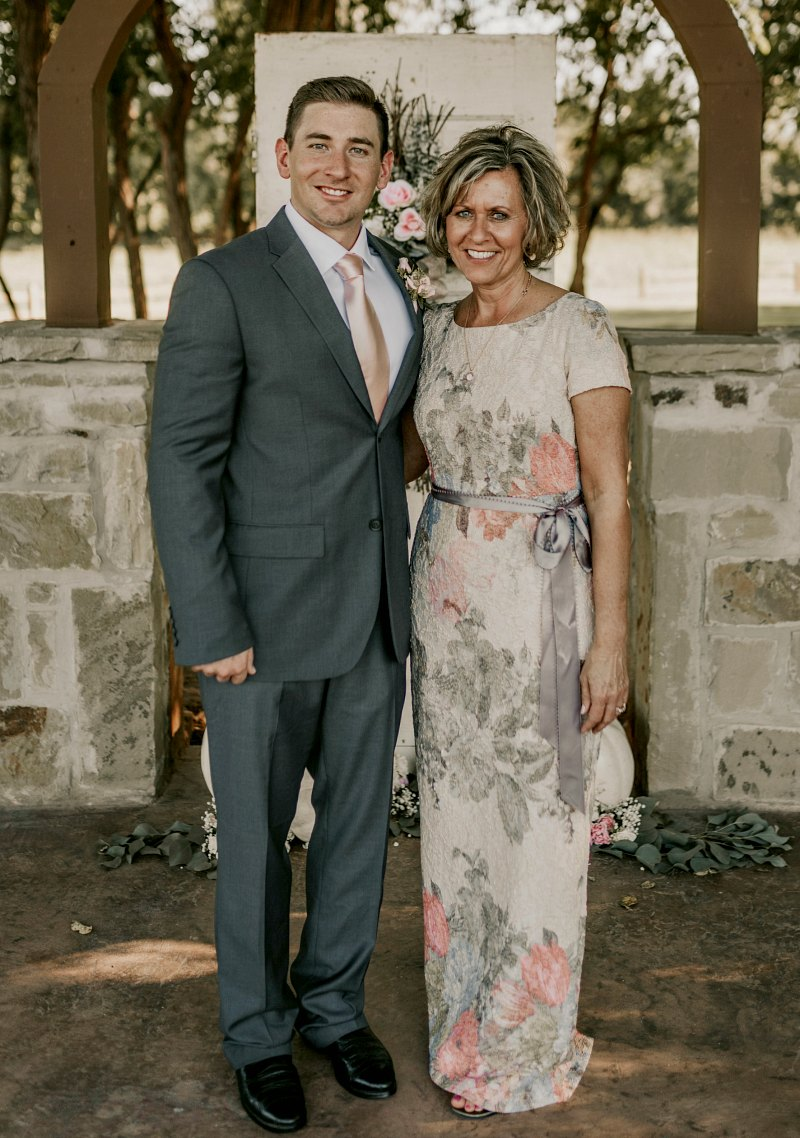 Mother of the Groom in peach Floral gown with groom