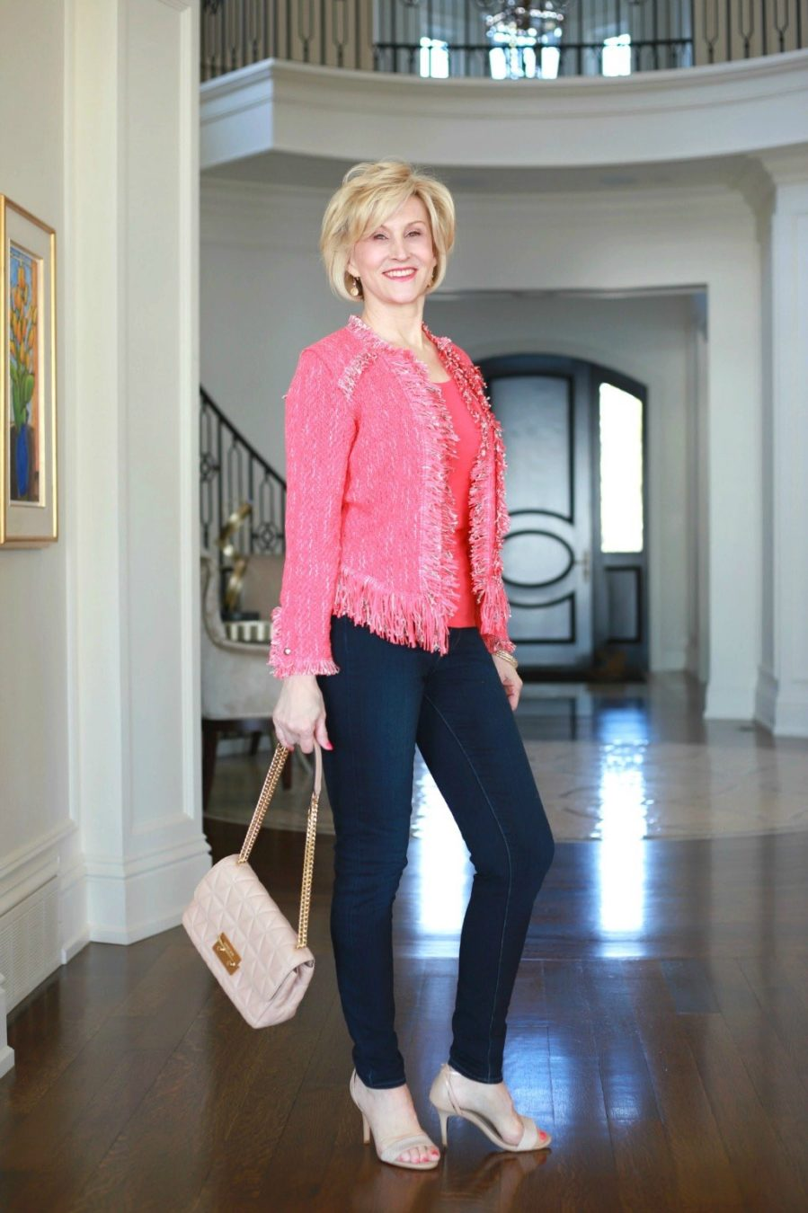 Coral Fringe Jacket, coral tank top, jeans and quilted tan shoulder bag worn by Deborah Boland