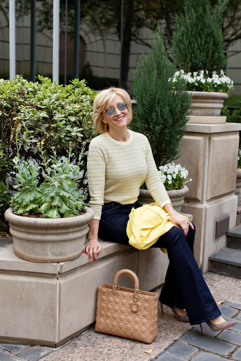 yellow sweater blue flare jeans